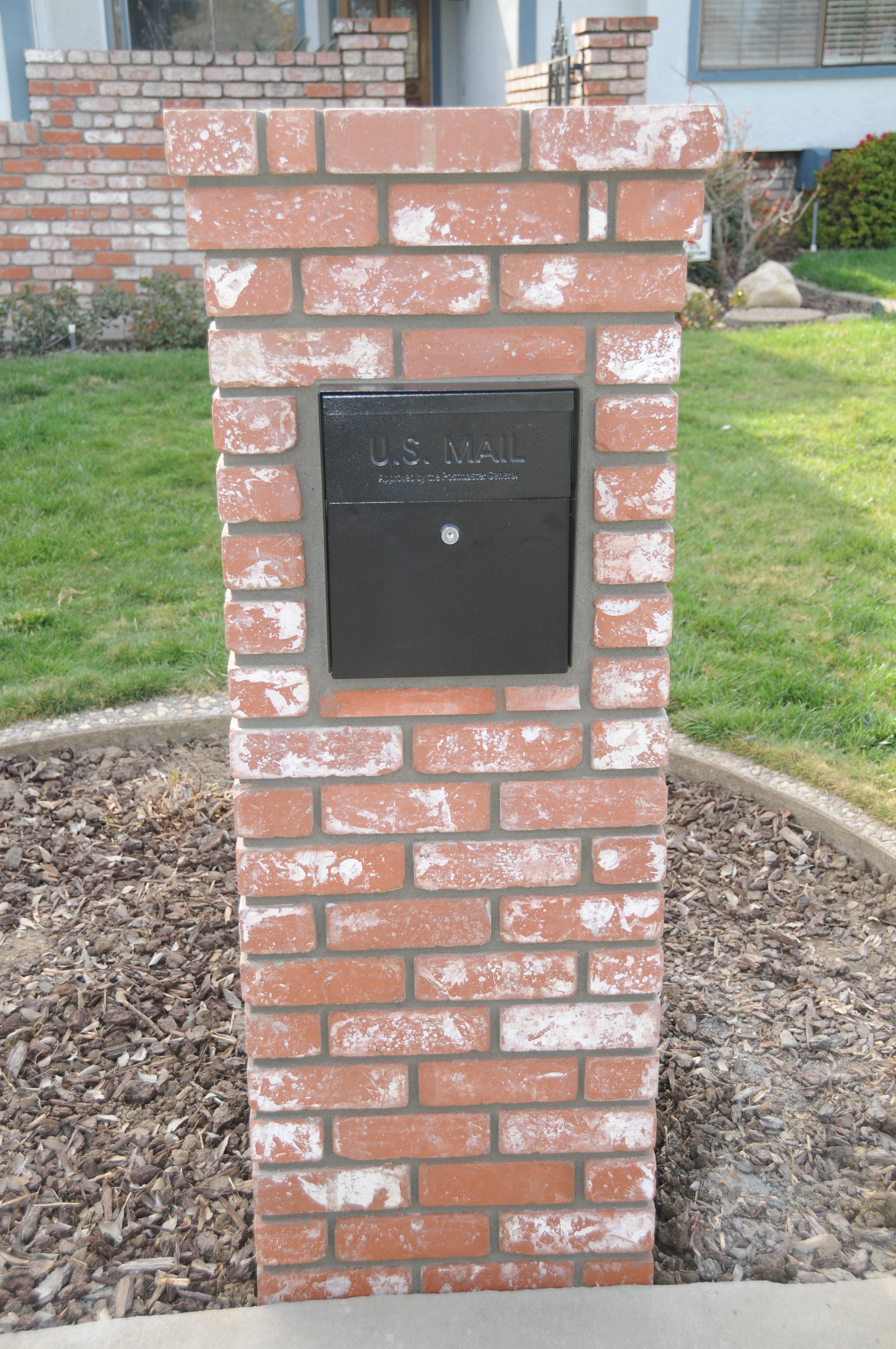 ... recently installed his Mail Boss security mailbox in a brick column